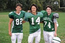 Brady Collins '12, Brandon Wu '12, and Ben Collins '12 play football together at Deerfield Academy