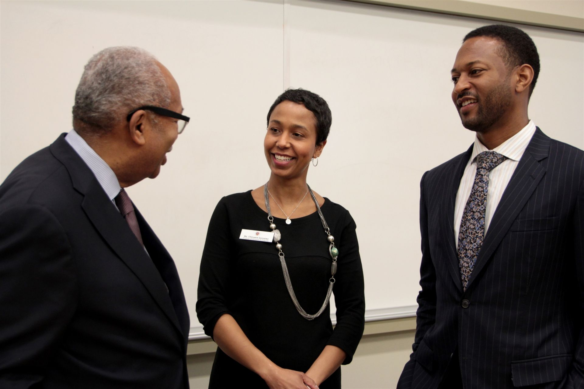 Mr. Green meets with Chinyere Gonzalez '90 and Leigh