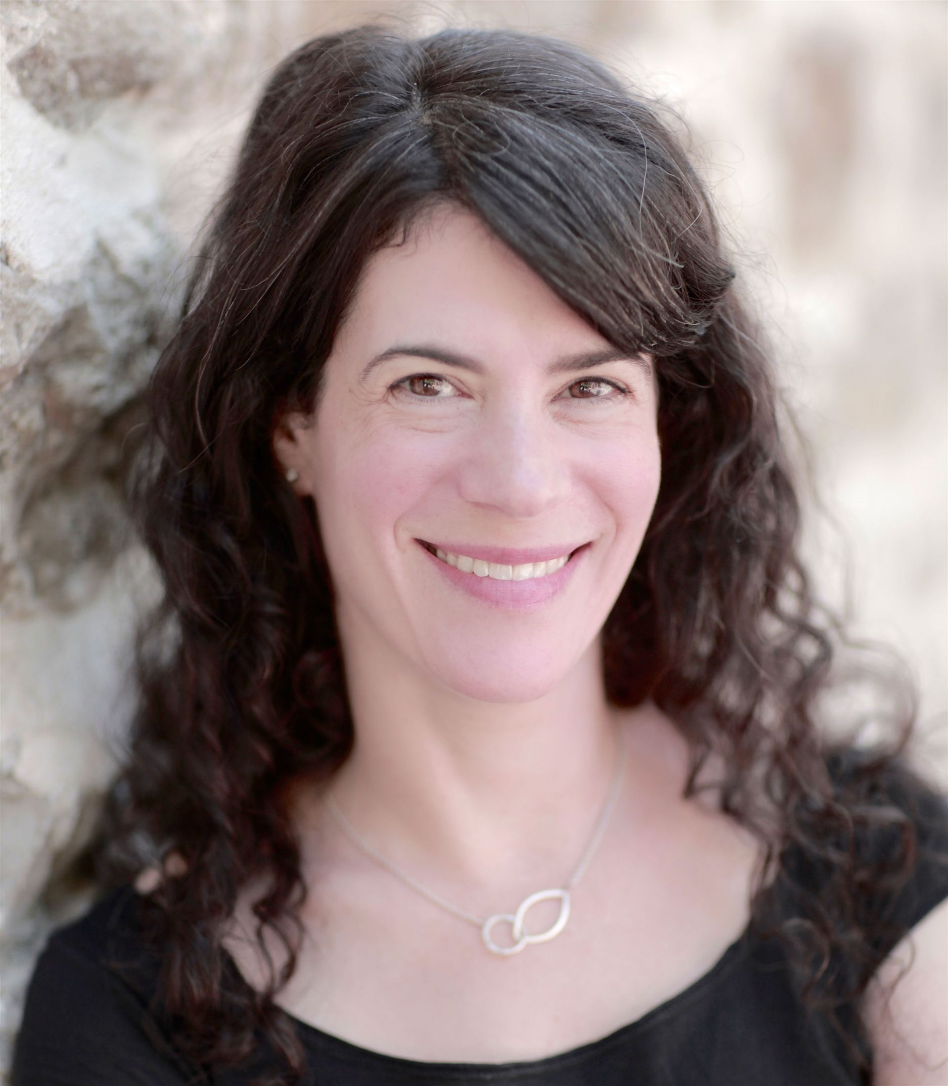 "Emily Barton '87 is an award-winning writer. Her first two novels, ""Brookland"" and ""The Testament of Yves Gundron,"" were named New York Times Notable Books of the Year. Her new book, ""The Book of Esther,"" was published in June 2016. Her work has been recognized by the Guggenheim Foundation, the National Endowment for the Arts, and the Sustainable Arts Foundation, and she has received the Bard Fiction Prize. Photo credit: Greg Martin"