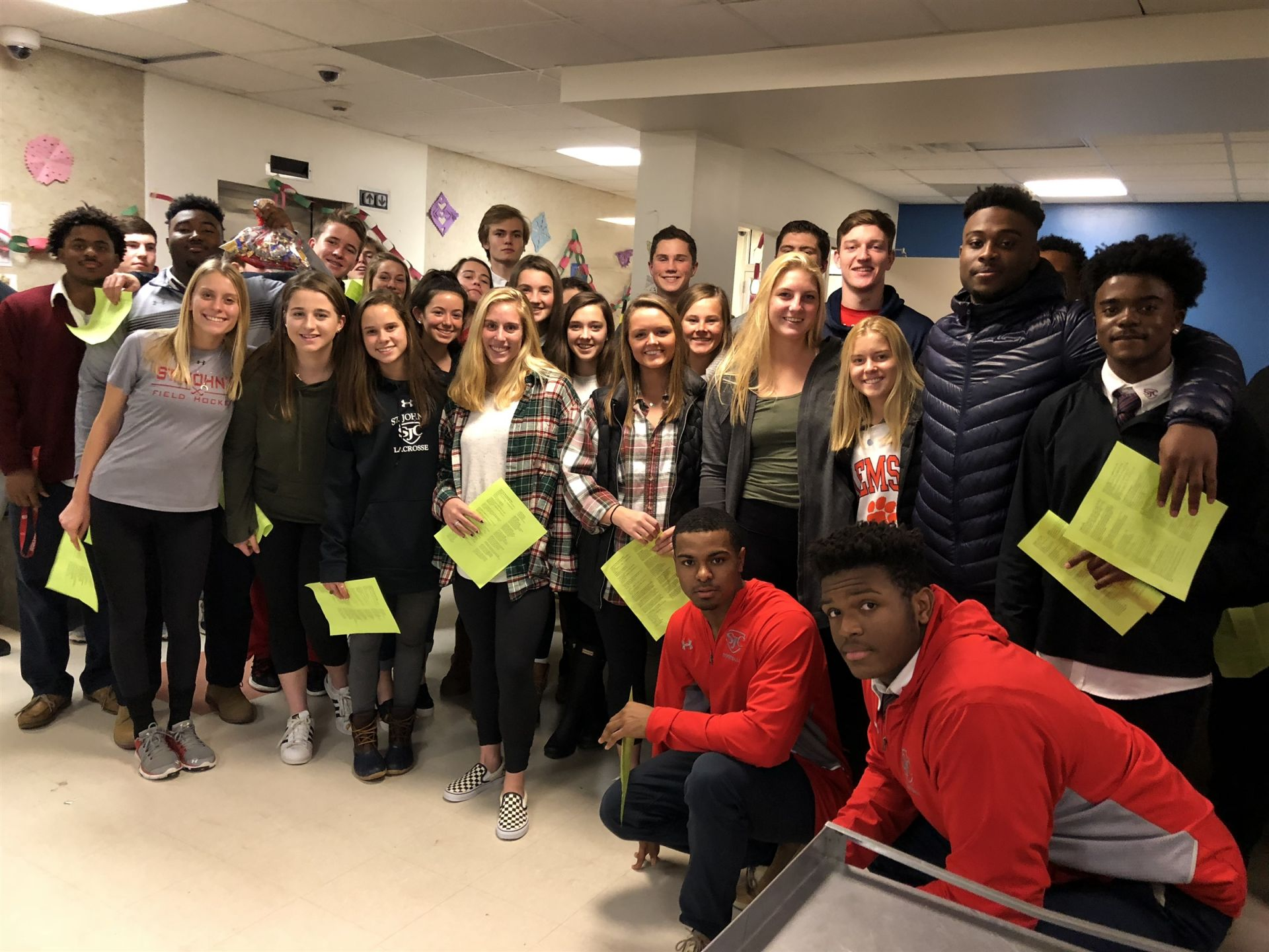 Girls Field Hockey, Girls Lacrosse, and Football caroling at the Catholic Charities Women's Shelter