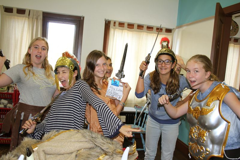 Seventh graders reenacting lessons learned surrounding the Fall of the Roman Empire.