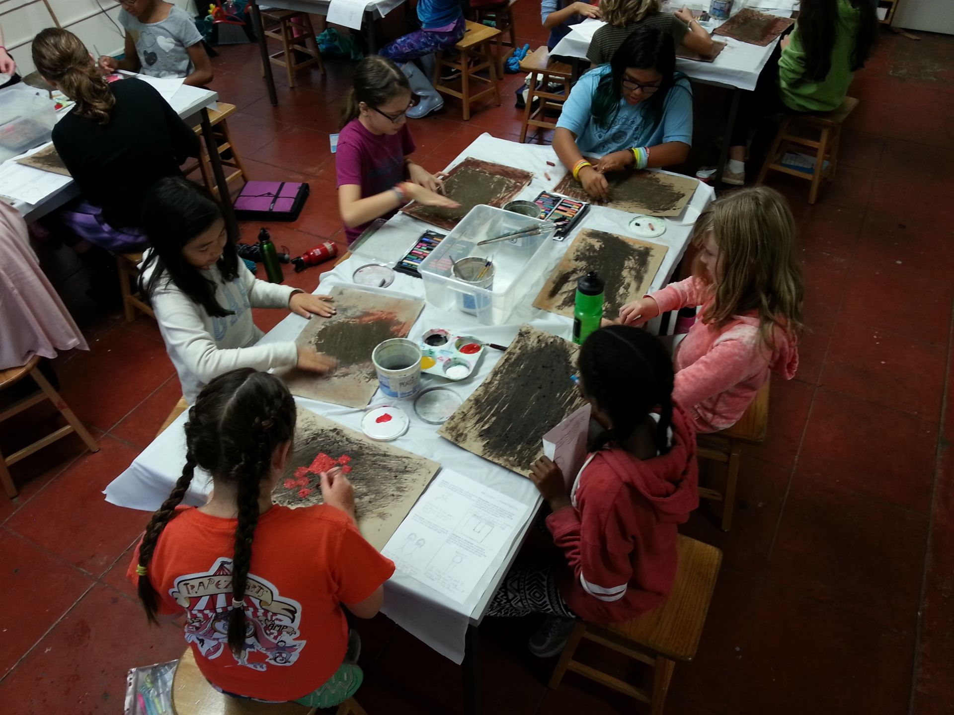Sixth graders imagine and create cave painting in Art class.
