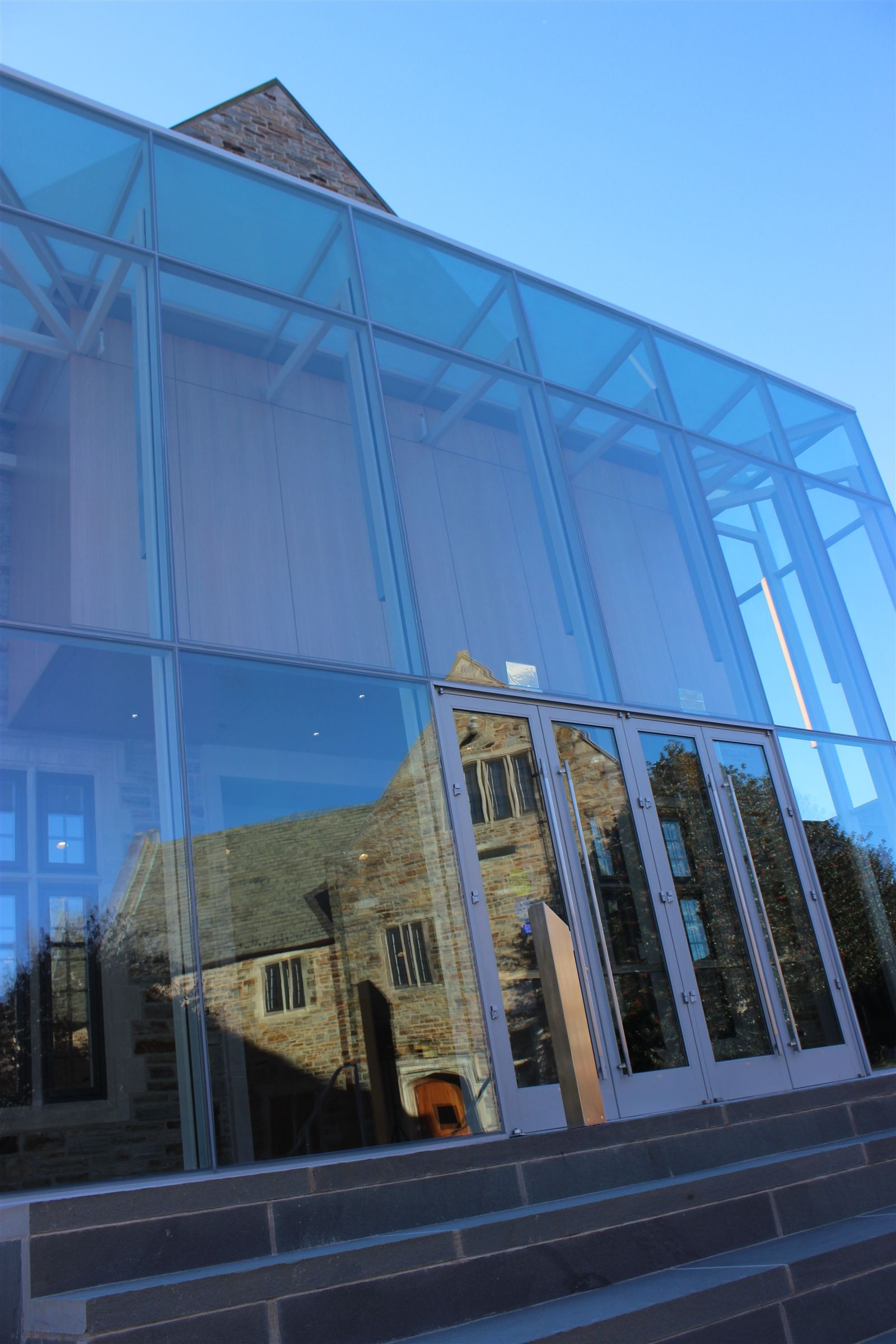 Upper School Building reflected in the Glass Atrium