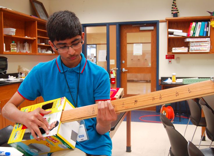 Freshmen create and play their own instruments in Physics class.