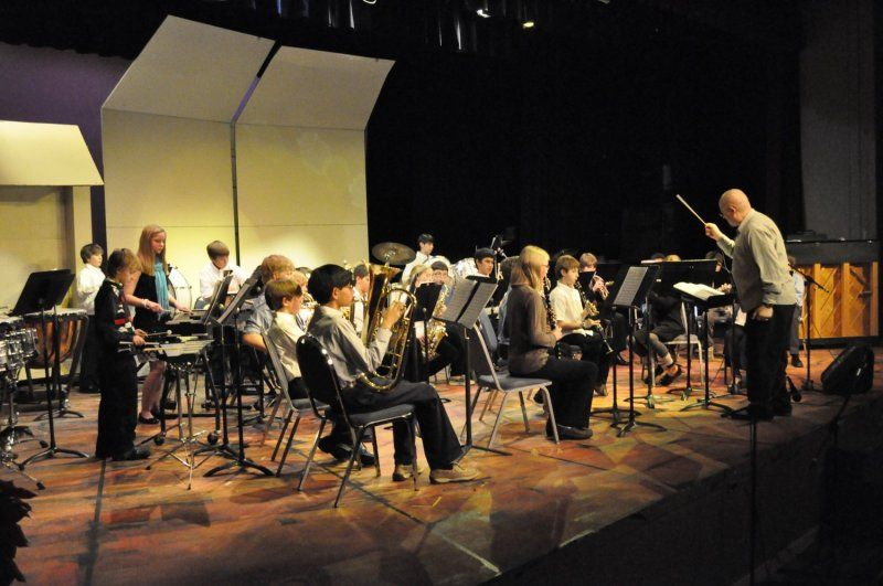 Choral and band classes have formal winter and spring performances, fifth and sixth grades each produce productions, while seventh and eighth grade students collaborate for a full-state musical.