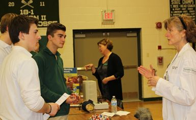 Sophomores Cavan Lamontagne, Jon Burke and Colby Scott chat with Dr. Healey about her career in medicine.