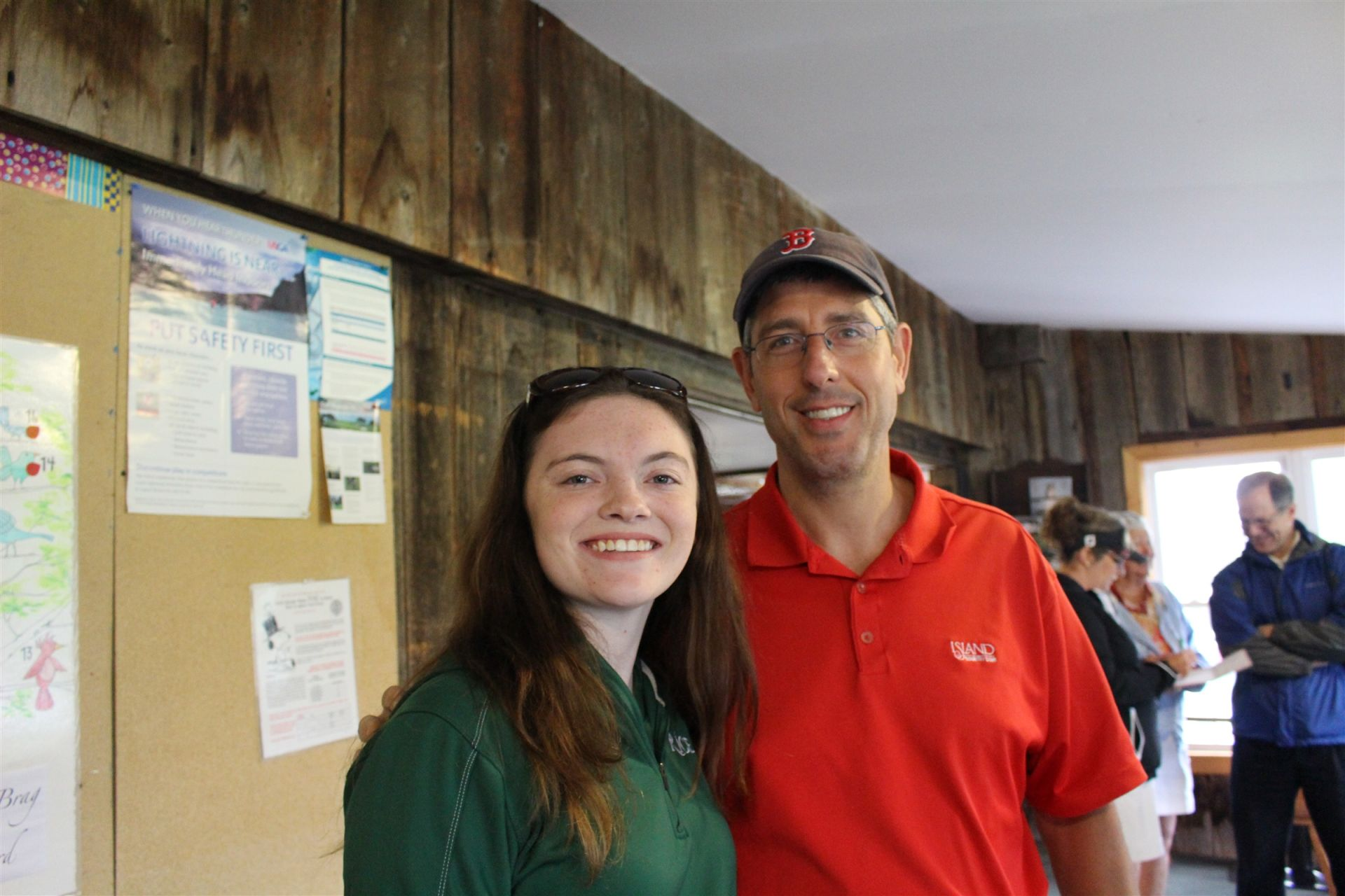 Golf team representative Elizabeth Hunt '17 and Coach Father Dallas St. Peter