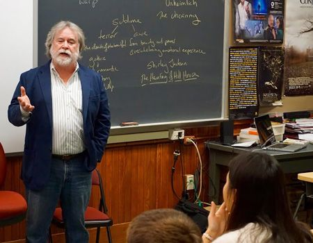 Author Dwayne Ritter '59 addressing English class