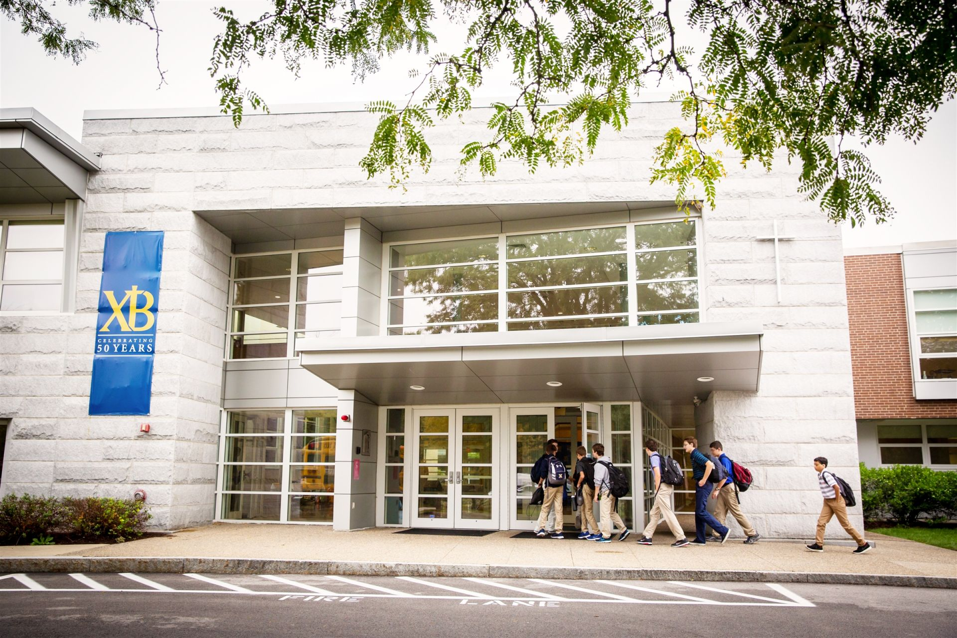Buses transport students from 17 stops to the Bisson Foyer each morning. The 34E MBTA bus also stops here daily, and the Islington commuter rail station is less than a mile's walk from campus.