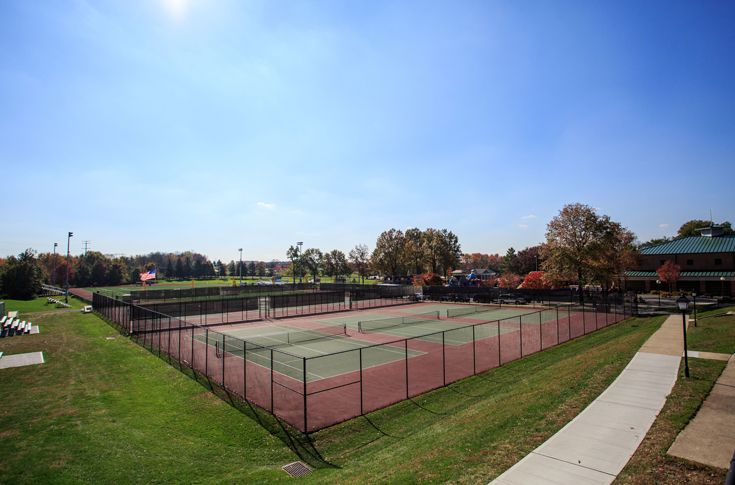 Ten newly resurfaced Tennis Courts reside adjacent to the Fieldhouse.