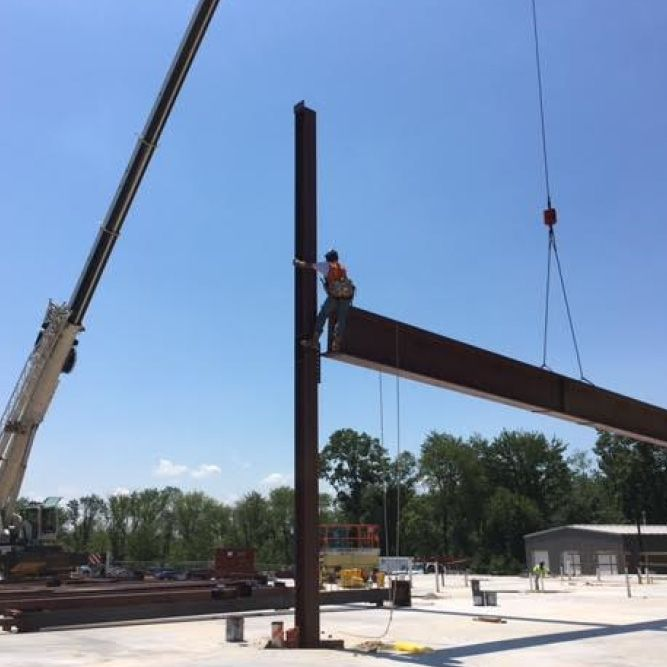 Construction workers use the 40-foot crane to complete the steel framing. (July 21, 2016)