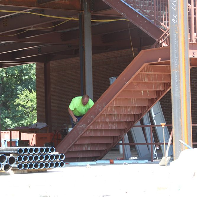 Hard at work on the interior staircases. (August 24, 2016)