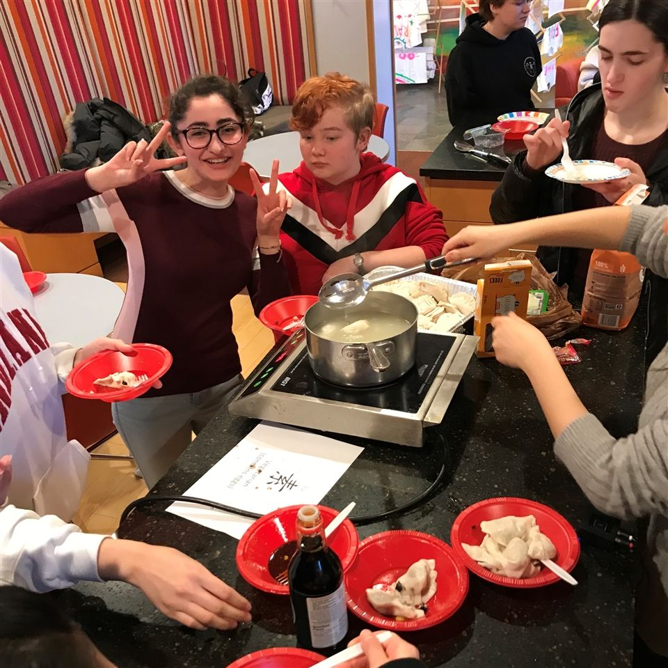 Sarah with her classmates in Mr. Sundin's Chinese class, learning to make dumplings