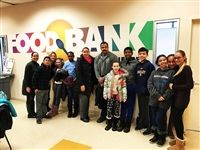 Hackley teacher Mrs. Louros, middle school students, and parent volunteers at the Food Bank of Westchester.