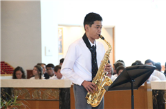Jameson Hardy '19 plays the saxophone at this year's Convocation.