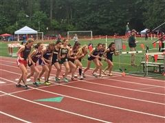 Annie Wright runners Sofia Huboly (4th from left) and Anna Haddad (far right) poised for the 1600m