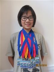 Pauline displays her eight medals from the PNS long course swimming meet