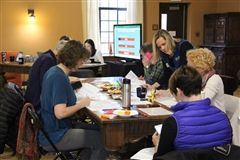 The Great Hall was abuzz with parent volunteers and staff charting progress.