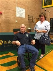 Joe LaRose receives a BG chair in recognition of his 25 years to the school.