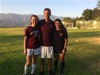 Todd Anckaitis, head coach of women's soccer at Swarthmore College, pictured with Miranda Saldivar '13 and Lauren Savo '16.