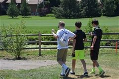 Three Middle School students walking the CA Campus in search of Pokémon creatures.