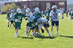 Varsity lacrosse battles for victory against a rival.