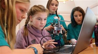 Eleven-year-old Danica Adams from Barnhill Memorial School works on some coding at the inaugural FIRST LEGO League robotics tournament at Rothesay Netherwood School on Nov. 29. To her left is Anneke Gerrits, 11, and to her right is Malea Simpson, 10, and Kaitlyn Young, 11, all of Barnhill school. Photo: Joshua Fischlin | Telegraph-Journal