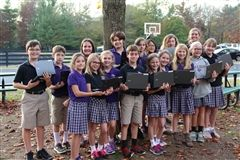 The 4th and 5th grade Paw Print staff on location with their Google Chromebooks
