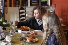 Sixth graders sat down to enjoy afternoon tea, a longstanding English tradition.