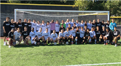 Alumni and varsity soccer players snap a pic prior to the annual match