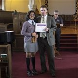 Liora receives her certificate from Mr. Lewis.