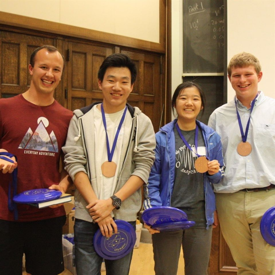 Christian Coffman (faculty chaperone), Kevin Wang '20, Hanji Xu '21, and Tom Powell '22 with their Yale Physics Olympics trophy