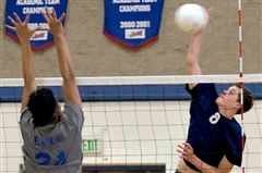 Philip Fauntleroy of Laguna Blanca rips a spike against El Rancho blocker Anthony Martinez during Tuesday's CIF semifinal match. (JC Corliss / Noozhawk photo)