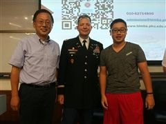 Warren Zhang spoke about  leadership at a conference held at Peking University, attended by a leadership professor (left) and Col. Woodruff of West Point Academy.