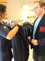 Roberto Flores gets fitted for a jacket with the help of Natalia in the Campus Shop. Roberto, from Mexico, is entering grade 11.