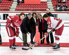 Tournament namesake Gary West was unable to attend, so his children (l-r) Bruce, Lynda, and Rachel stepped in to drop the ceremonial puck. Shown here with Paul Bedard, Tournament Convener, SAC captain Nolan Garnett, and the captain of Montreal's College Jean-Eudes.