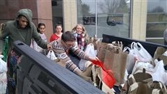 Students Help Load Hundreds of Canned Goods Bound for Christ House and Two Other Local Food Banks