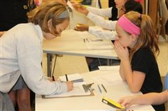 Lower school girl registers to vote with the