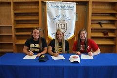 Marian Seniors Colleen Grombala, Lauren Ogurek, and Maria Hickey signed national letters of intent to play their sports in college next fall.