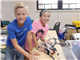 Students get hands-on with a creation in Robotics Engineering, one of the most popular camps at Summer at TMI 2016.