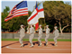 An all-female color guard from the Texas Military Institute Corps of Cadets takes the field at the March 22 grand opening ceremony for the new TMI softball complex.