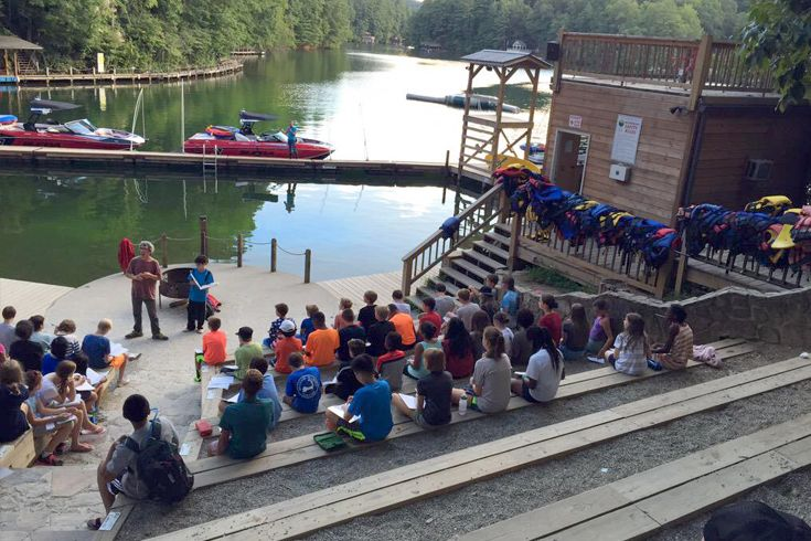 Grades 6-7 spend an evening of reflection after a day of fun and challenging activities at camp during their annual field trip week.