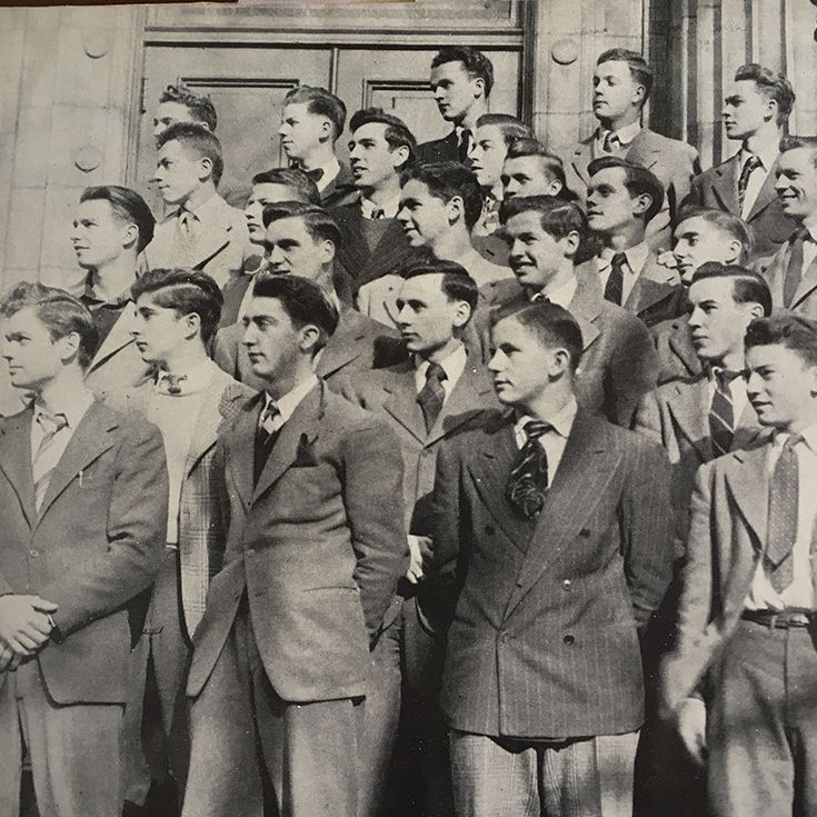A group of students who served in the Armed Forces during World War II stands on the stairs of Dooley Hall before departing for war.