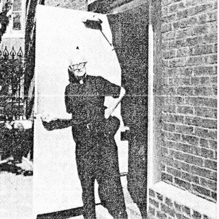 This photo shows Father Horace B. McKenna, SJ, opening the door to what's now The McKenna Center, in the basement of St. Al's.
