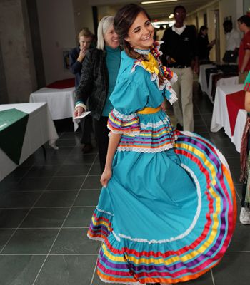 A student wears a traditional Mexican dress during the annual Walk Around the World international celebration
