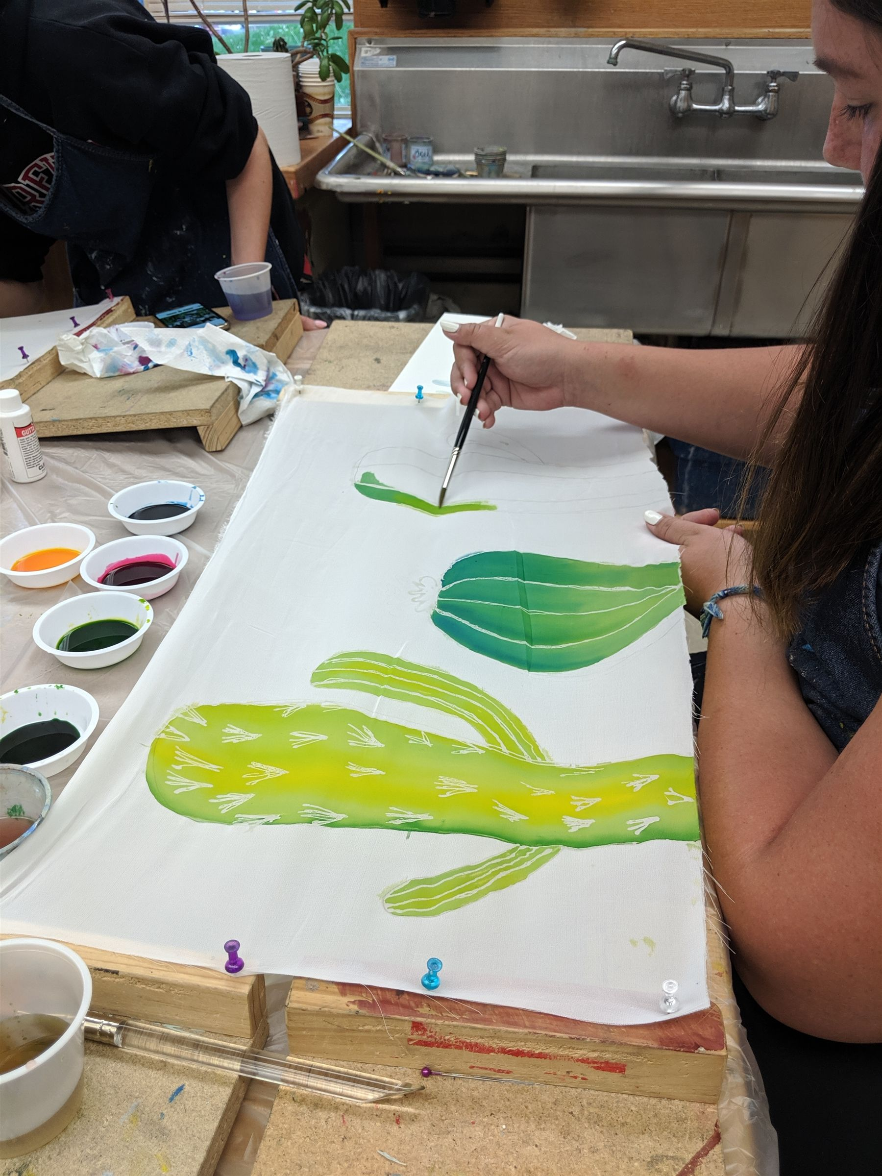 Students in Mrs. Zweir's Art III class learn new techniques of painting on silk.