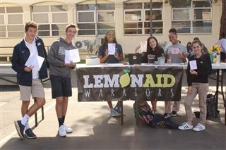 The LemonAid Warriors write cards for the children at St. Jude's Hospital