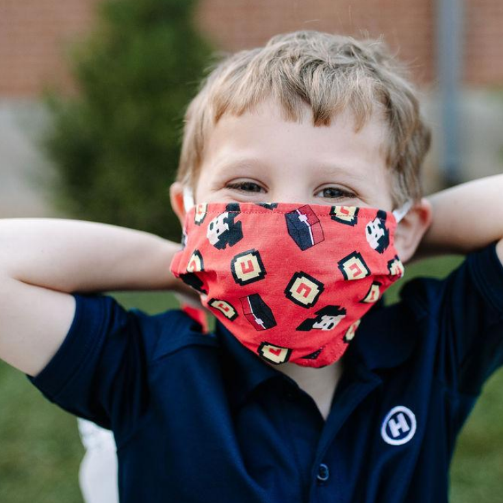 Boy with red mask