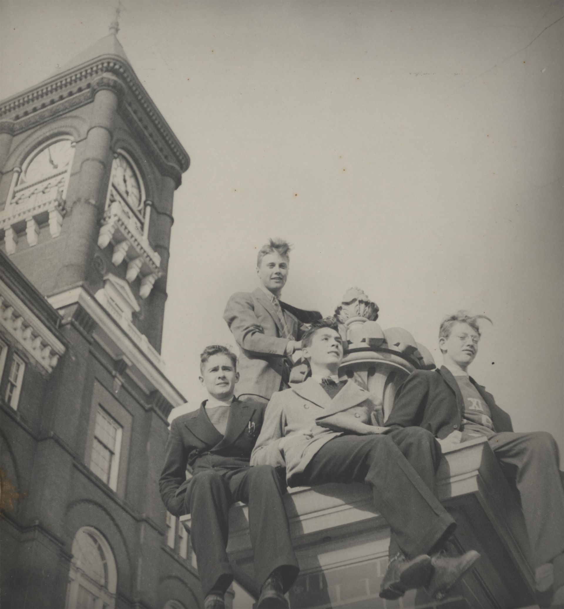 1938 Students on front steps with clock tower