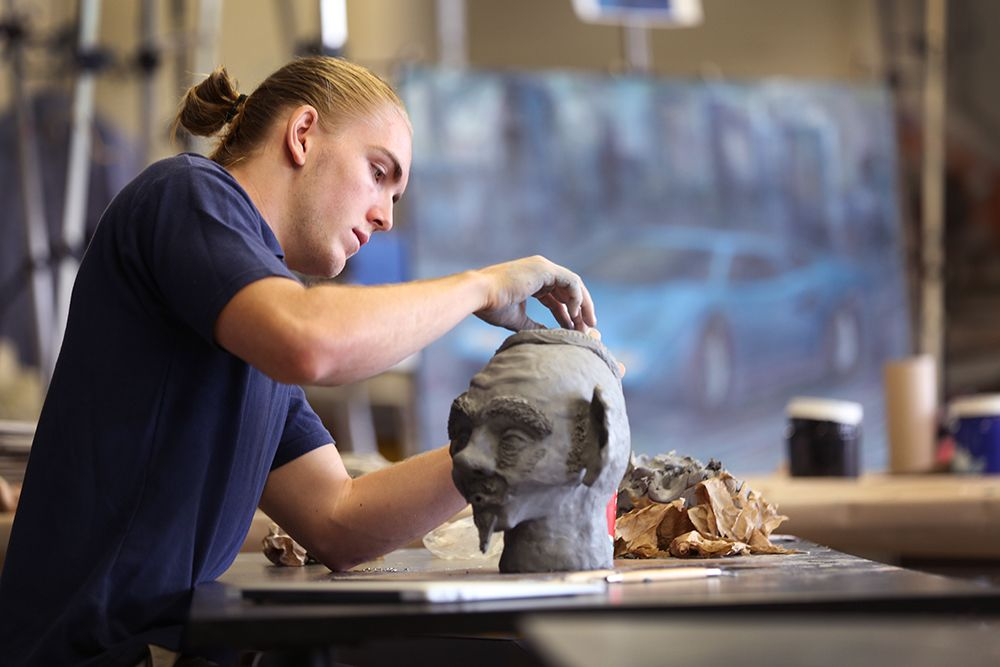 student sculpting